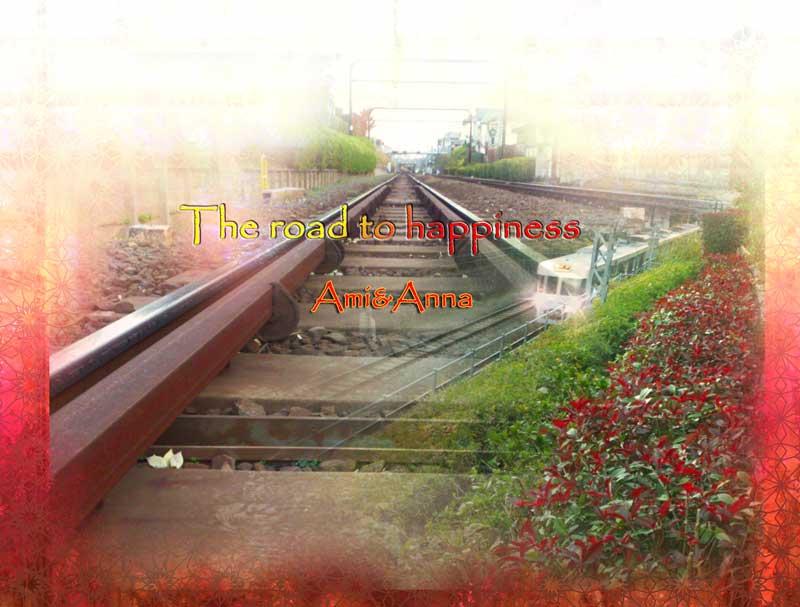 長い真っ直ぐな線路と交差して走っている電車