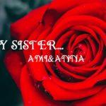 水滴がついた真っ赤なバラの花にMY SISTERの白いテキスト