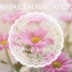 ピンクの花に美・フェイスナビゲーターのロゴ