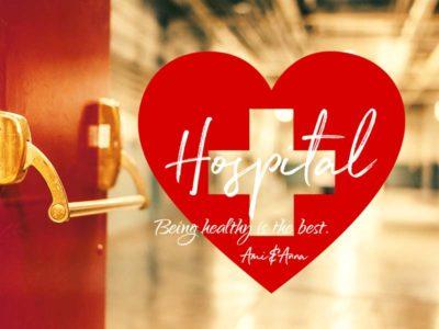 赤い病院の扉と赤いハートのグラフィック画像
