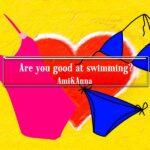 背景がハートでブルーのビキニとピンクの水着のグラフィック画像